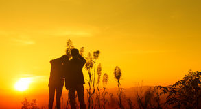 Sunset silhouette teen feeling Happy Stock Images
