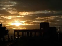 Sunset. And a silhouette of an unfinished building royalty free stock photos