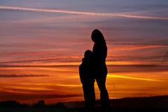 Sunset silhouette. Of woman and child Royalty Free Stock Images