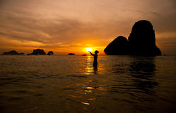Sunset silhouette. Of woman and sun in Thailand Royalty Free Stock Photography