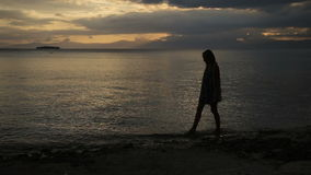 Sunset silhouette of women on the beach stock video