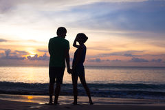 Sunset silhouette of young couple in love walking Royalty Free Stock Photo
