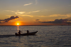 Sunset and silhouettes on boat cruising the Amazon River, Brazil Royalty Free Stock Photos