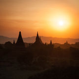 Sunset silhouettes of Buddhist Temples at Bagan Kingdom, Myanmar Royalty Free Stock Photography