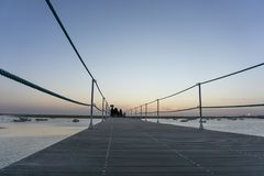 Sunset silhouettes centered Faro Portugal stock photography