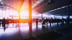 Sunset Silhouettes of Commuter in Airport. stock video