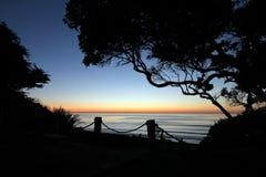Sunset with Silhouettes. A sunset with silhouettes at Del Mar beach Royalty Free Stock Image