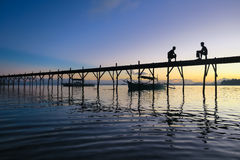 Sunset silhouettes on the pier - Siargao, Philippines royalty free stock photography