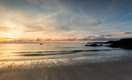 Sunset Silhouettes, Porthcothan beach, Cornwall stock images