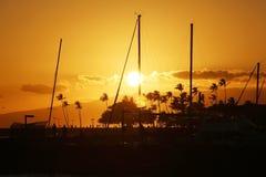 Sunset silhouettes on Waikiki Beach. Oahu, Hawaii Royalty Free Stock Photo