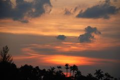 Sunset on Singapore beach. Sunset over Sentosa beach Singapore Royalty Free Stock Image