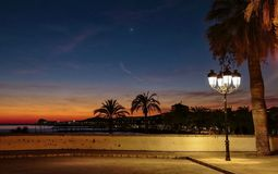 Sunset on Sitges , spanish Catalonia. Beautiful sunset and street light on Sitges village in spanish Catalonia near Barcelona stock illustration