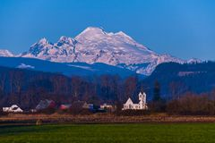 Sunset on Skagit Valley with Mount Baker in Background. Sun setting on Mount Baker from Skagit Valley with church in foreground Royalty Free Stock Photos