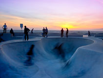 Sunset Skate. California skateboarders at the seaside park are silhouetted against the sunset Royalty Free Stock Image
