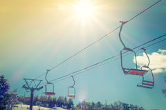 Sunset and  Ski lift going over the mountain Royalty Free Stock Photography