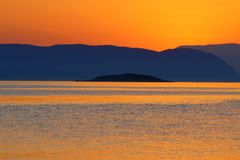 Sunset at Kastani beach, Skopelos, Greece. Sunset on Skopelos just before dark with orange colored sky royalty free stock photo