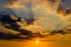 Sunset sky. With nice clouds and golden sun Stock Photography