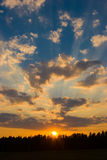 Sunset sky. With nice clouds and golden sun Stock Images