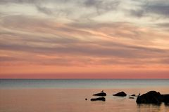Sunset sky. Red sunset sky with rocks on foreground Royalty Free Stock Photography