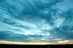 Sunset sky. Sunset of a sunny day with some clouds Stock Photography
