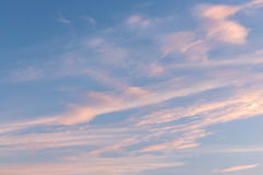 Sunset sky background. Sunset blue sky background with pink clouds Stock Photo