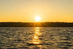 Sunset sky background. Dramatic gold sunset sky with evening sky clouds over the sea. Stunning sky clouds in the sunrise. Sky land. Scape. Panoramic sky view stock images
