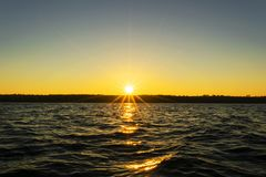 Sunset sky background. Dramatic gold sunset sky with evening sky clouds over the sea. Stunning sky clouds in the sunrise. Sky land. Scape. Panoramic sky view royalty free stock photo