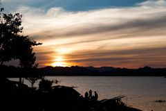Sunset sky in campsite near the lake, Twilight sky, Travel and C. Amping concept Royalty Free Stock Images