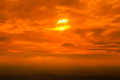Sunset sky with cloud over the mountain range. Orange sunset sky with cloud over the mountain range Stock Photo