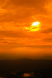 Sunset sky with cloud over the mountain range. Orange sunset sky with cloud over the mountain range Royalty Free Stock Photo