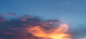 Sunset sky clouds background. Beautiful sunset sky with clouds in summer time royalty free stock photos