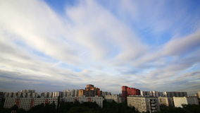 Sunset sky clouds close. Clouds floating over the city stock footage