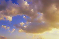 Sunset sky with clouds. Close up view of fluffy clouds colored by the setting sun Stock Photography