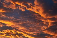 Sunset sky clouds. Dramatic sunset clouds glowing in twilight Stock Images