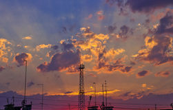 Sunset sky with clouds over the roof of the house. Royalty Free Stock Images