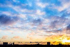 Sunset sky with clouds over urban houses in winter Royalty Free Stock Images
