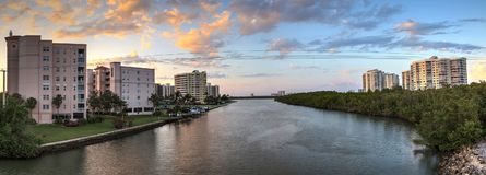 Sunset sky and clouds over the Vanderbilt Channel river Royalty Free Stock Image