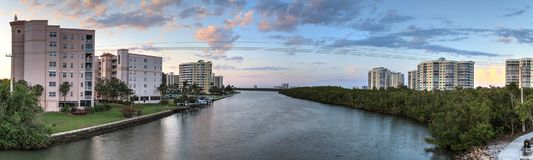Sunset sky and clouds over the Vanderbilt Channel river Stock Photos