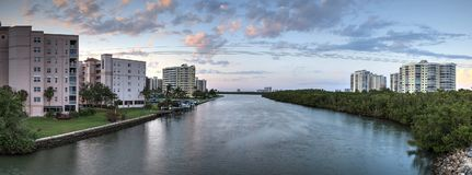 Sunset sky and clouds over the Vanderbilt Channel river Royalty Free Stock Images
