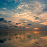 Sunset sky with clouds and reflection in water. Sunset sky with clouds and reflection in water nature background Royalty Free Stock Photos