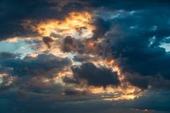 Sunset sky cloudscape. Dramatic sunset sky cloudscape nature background with copy space Stock Image