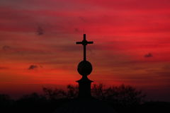 Sunset sky and the cross stock photo