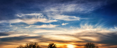 Sunset sky  with dramatic clouds - panorama Royalty Free Stock Photo