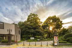 Sunset sky on the entrance of the Hibiya Park 日比谷公園 H. Ibiya Kōen in Chiyoda City of Tokyo in Japan. Its entrance is decorated stock photos