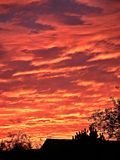 Sunset sky on fire. Deep red orange sky and clouds at sunset Stock Images