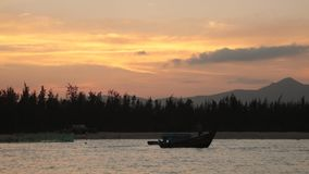 Sunset Sky With Fishing Boats. A fiery orange evening sky looking out over the south China sea in Vung Lam Bay Vietnam. With fishing boat silhouettes stock video