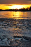 Sunset sky and ice lake Stock Photo