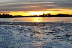 Sunset sky and ice lake Royalty Free Stock Photo