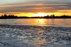 Sunset sky and ice lake Stock Image