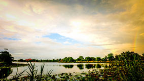 Sunset with sky. Sunset  with lagoon in Ratchaburi Thailand Royalty Free Stock Image